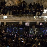 A sign reads 'not afraid' as thousands gather for a vigil on Place de la Republique in Paris on Wedn